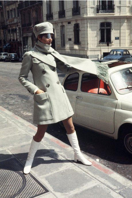 hows a model presenting a Ted Lapidus ready-to-wear creation in a Paris street. 1969